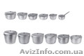 Алюминиевые литые кастрюли разных размеров.